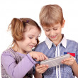 Little girl and boy fun with tablet pc on white — Stock Photo