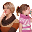 Smoking can cause asthma in children - Stock Photo