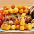 Chicken meat with bacon potatoes and tomato gourmet food - Stock Photo