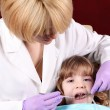 Stock Photo: Child patient at the dentist dental exam