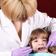 Child patient at the dentist dental exam — Stock Photo