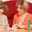 Vídeo Stock: Little girl working her homework and making mistake
