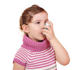 Little girl with asthma inhaler — Stock Photo