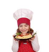 Little girl cook enjoys spaghetti — Stock Photo