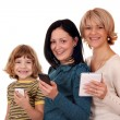 Three generation little girl teenage girl and woman with tablet  — Photo