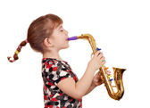 Beautiful little girl play music on saxophone — Stock Photo