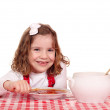 Royalty-Free Stock Photo: Happy little girl eat tomato soup