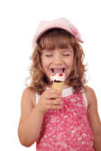 Happy little girl eat ice cream on white — Stock fotografie
