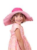 Glad liten flicka med stor hatt och klänning på vit — Stockfoto