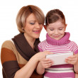 Little girl and mother play with tablet pc — Stock Photo