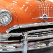 Stock Photo: Oldtimer car chrome bumper detail