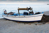 Twilight with old fishing boat on beach — Stock Photo