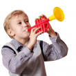 Boy play trumpet on white — Stock Photo