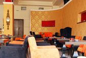 Cafe with orange walls interior — 图库照片