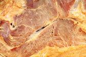 Smoked ham meat close up background — Stock Photo