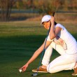 Girl golf player preparing for shot — Stok Fotoğraf #23798809