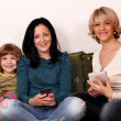 Little girl teenage girl and woman play with smart phones and ta — Stock Photo