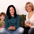 Foto de Stock  : Little girl teenage girl and woman play with smart phones and ta