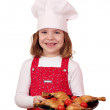 Happy little girl cook with delicious chicken drumsticks — Stock Photo #24148247