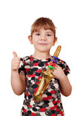 Little girl with thumb up and saxophone — Stock Photo