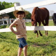 Little girl with cowboy hat on ranch - Foto de Stock  