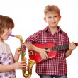 Little girl and boy play music — Stock Photo