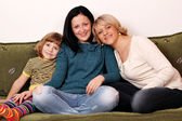 Little girl teenage girl and woman family scene — Stock Photo