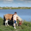 Little girl and pony horse — стоковое фото #25616195