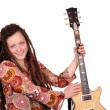 Happy girl with dreadlocks and guitar posing — Stock Photo