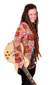 Happy girl with dreadlocks and electric guitar posing — Stockfoto