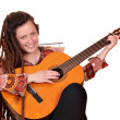 Happy girl with dreadlocks play acoustic guitar — 图库照片