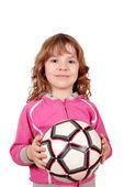 Happy little girl hold soccer ball — Stock Photo