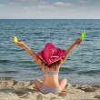 Happy little girl with hat looking at the sea — Stock Photo