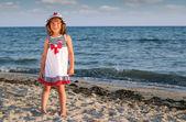 Beautiful little girl on beach summer scene — Photo