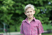 Happy boy portrait in park — Stock Photo