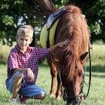 Happy boy and pony horse — Stock Photo #28616737