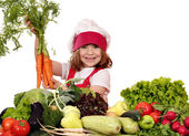 Happy little girl cook holding carrot — Stock Photo