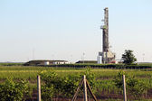 Landscape with oil drilling rig — Stock Photo