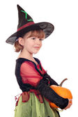 Little girl witch holding pumpkin on white — Stock Photo