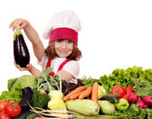 Little girl cook holding aubergine — Foto Stock
