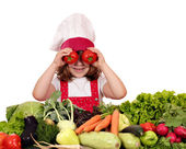 Little girl cook with tomato eyes — Stock Photo