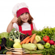 Happy little girl cook with thumb up and vegetables — Stock Photo