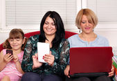 Three generations girls with computers — Stock Photo