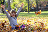 Beautiful little girl in autumn park — Stock Photo