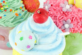 Colorful sweet cupcakes dessert food background — Stock Photo