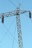 High voltage electric pylon and cables — Stock Photo