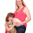 Happy pregnant mother and daughter — Stock Photo