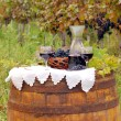 Stock Photo: Red wine and grape on barrel