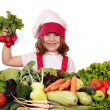 Happy little girl cook holding radish vegetables — Stock Photo