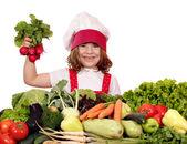 Happy little girl cook holding radish vegetables — Stock Photo